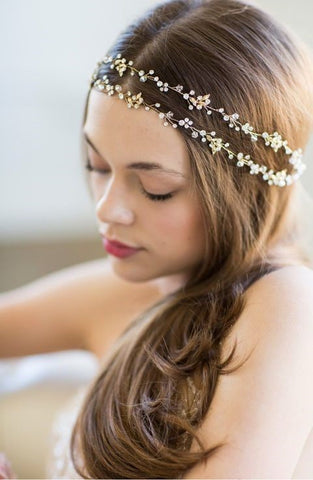 This unique bohemian bridal flower crown is crafted with 24-karat gold-plated details that are secured with pins against some bohemian-styled braids, or wear it with a removable rear headband.