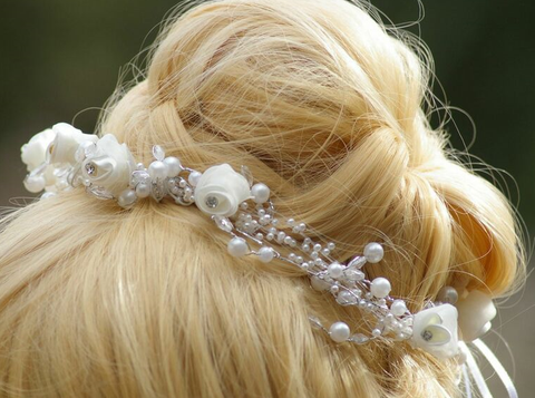 This twinkling accessory is a starfish-embellished headband surrounded by sparkling rhinestones and freshwater pearls