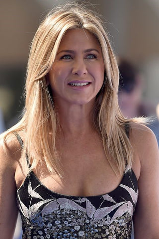 Jennifer Aniston hairstyles Middle-Parted And Long Bangs For A Gently Look