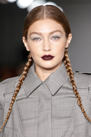 Wondering what's the most surprising look of this Milan Fashion Week? And the first one coming up our mind is Pigtail braids - the kind you wore when you were, like, four or five years old