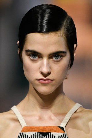 Prada and Giada introduced the perfect option for the woman who just doesn't do messy: the sleek side part
