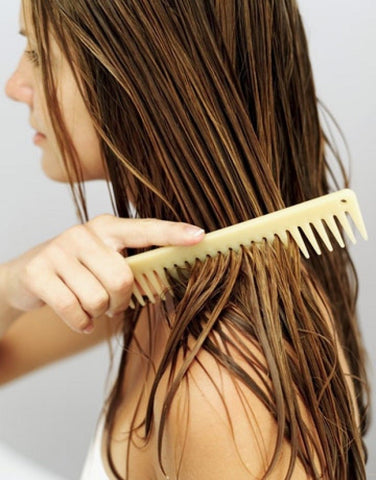 Using a wide tooth comb large - MCSARA Hair