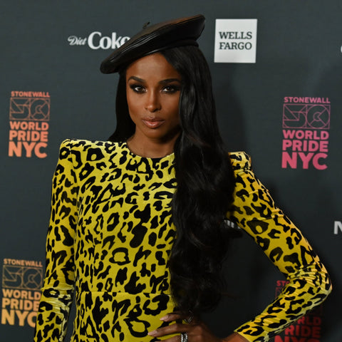 The singer went on the carpet with a black wavy hairdo combined with a black beret. Paired with a yellow-and-black leopard-print, she looked absolutely outstanding in this event.