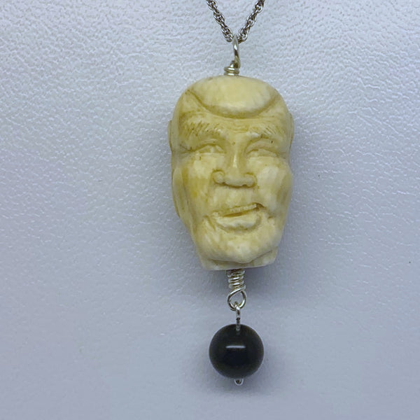 hand carved bone Luohan face pendant #191