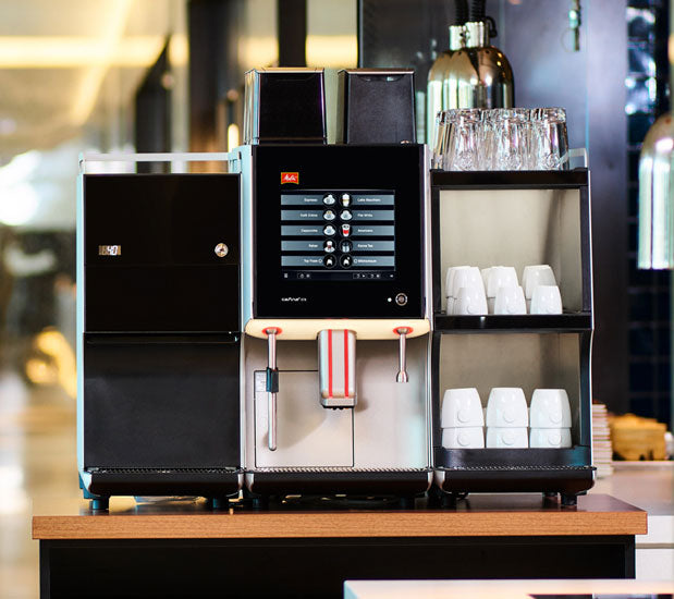 Melitta XT8 Coffee Machine with cup warmer and milk cooler on a counter in a cafe