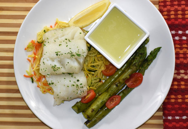 Poached Cod, Zoodles, Asparagus and Grape Tomatoes with Garlic Wine Sauce