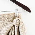 image of tie front skirt hanging on hanger, detail of tie