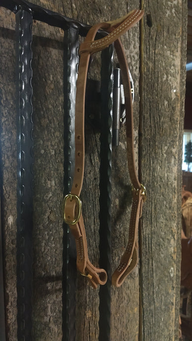 One eared headstall with quick change connector