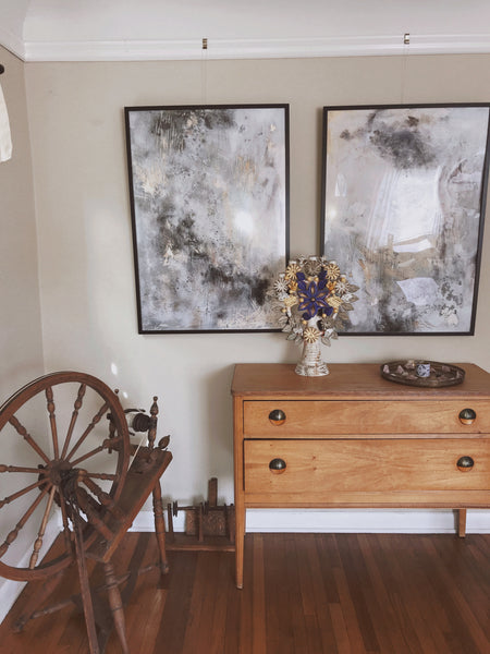 Intentional home decor: family heirlooms displayed with the artist's own paintings