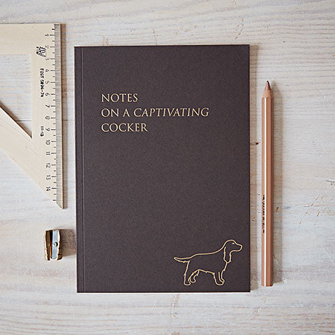 cover of captivating cocker notebook