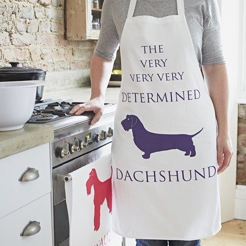 determined dachshund purple apron by bottlegreenhomes