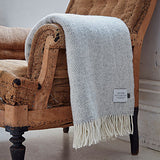 light grey cashmere merino throw on arm of chair - bottle green homes