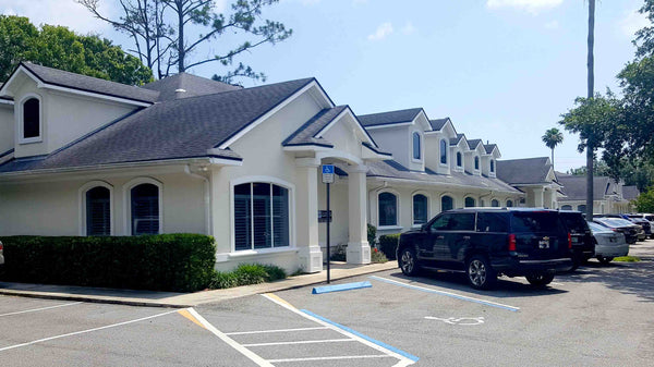 Legal Team  _ Law Office of Suzanne Green Outside building salano road ponte vedra