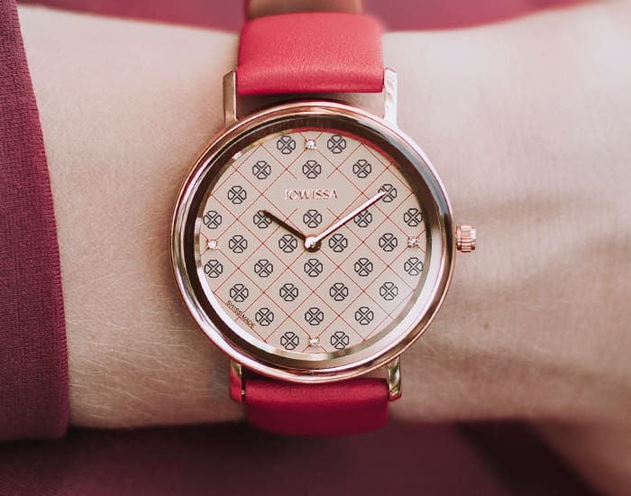 Woman wearing a red AnWy minimalistic Swiss ladies watch in 35mm size by Jowissa