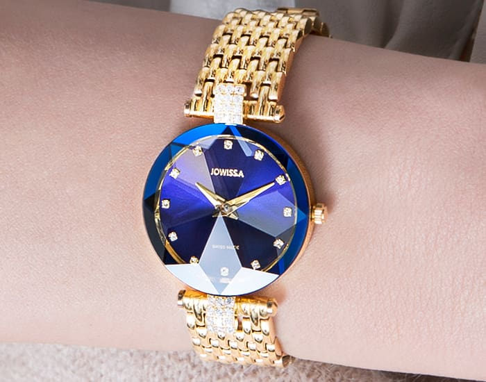 Woman wearing a gold blue Facet Strass Swiss Ladies watch in 30mm size by Jowissa