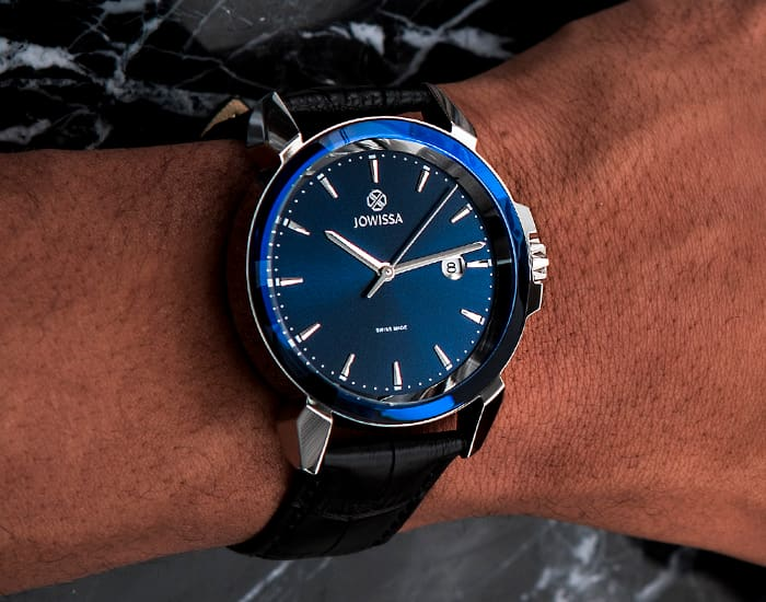 Man wearing a blue LeWy 3 Swiss men's watch by Jowissa on his wrist, size 42mm