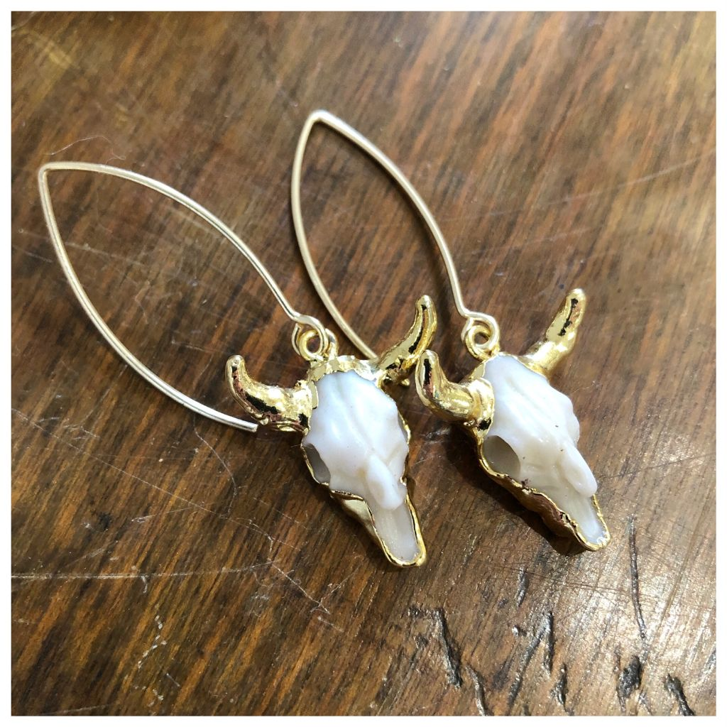 Golden cow skull earrings