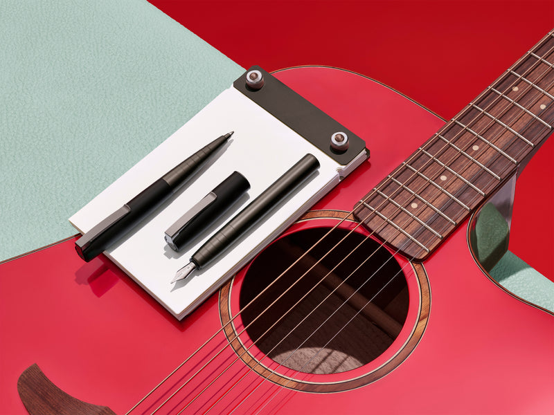 LOOM Fine Writing Collection pens on a guitar
