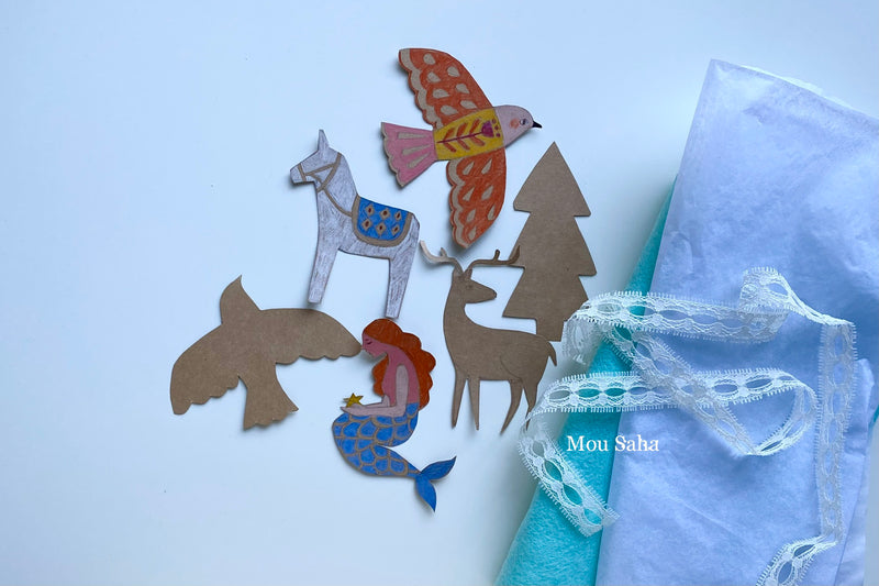 Donkey, bird, and mermaid gift toppers