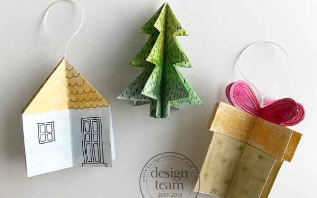 Handmade Christmas ornaments: a house, tree, and Christmas present