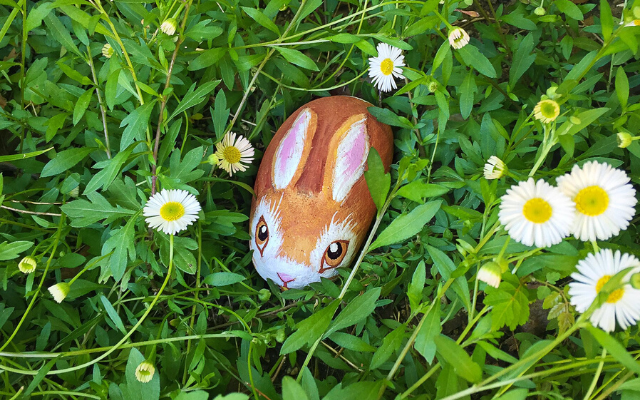 Rock painting bunny in grass