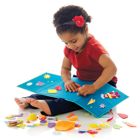 Girl playing with Fun Felt Shapes