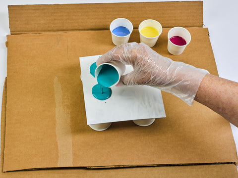 Canvas board with paint cups