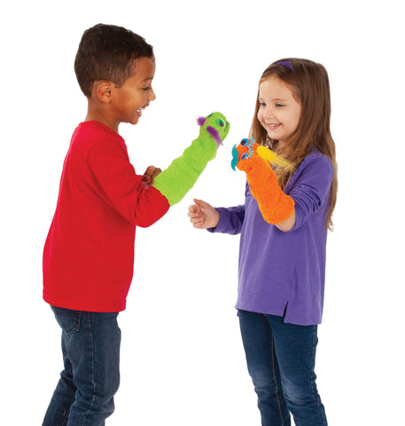 Two kids playing with sock puppets