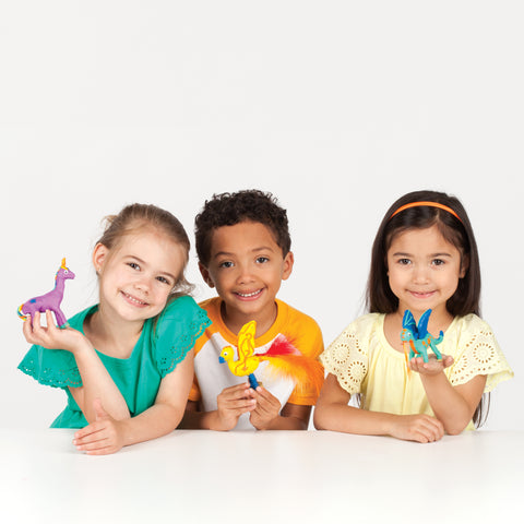Three kids with Create with Clay Mythical Creatures
