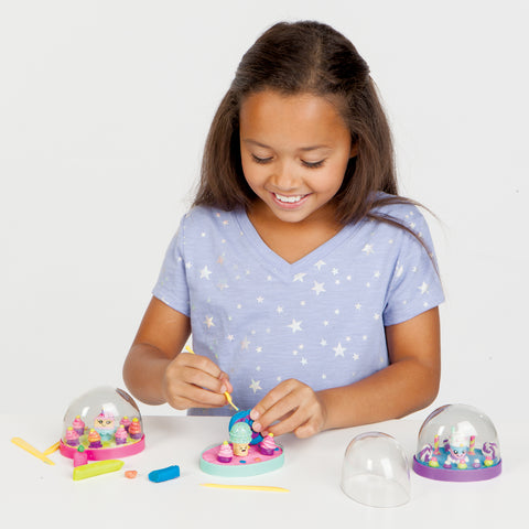 Girl making a Make Your Own Water Globe
