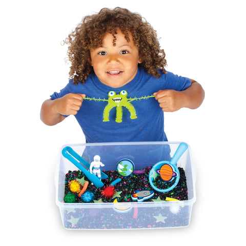 Child playing with outer space sensory bin