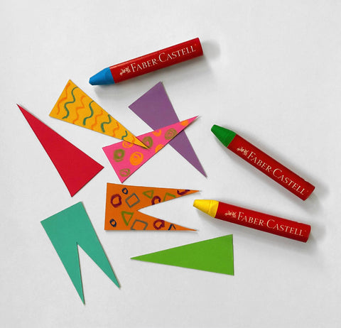 Paper pieces with design and Beeswax Crayons