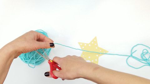 Yarn Ball Cut with Scissors