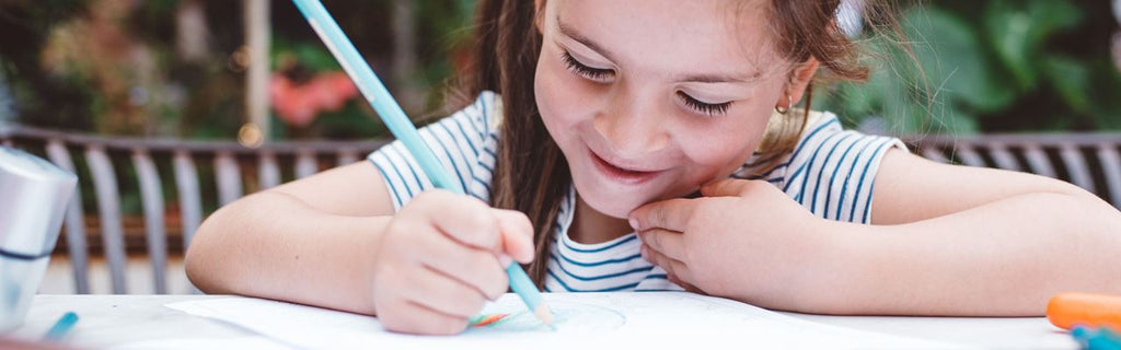 Girl coloring with color pencil