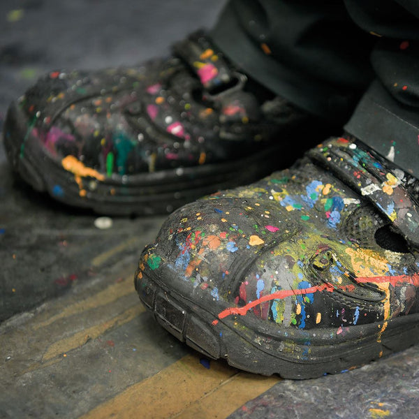 Work boot splattered with paint