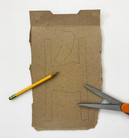 Cardboard with pencil and scissors