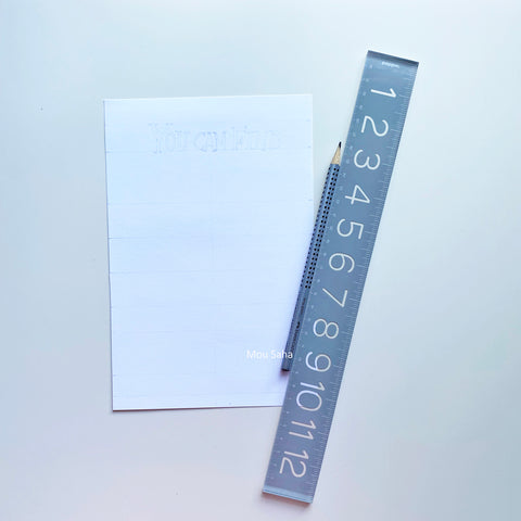 Paper with sketch and pencil and ruler