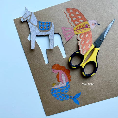 Donkey, bird, and mermaid cut out with scissors