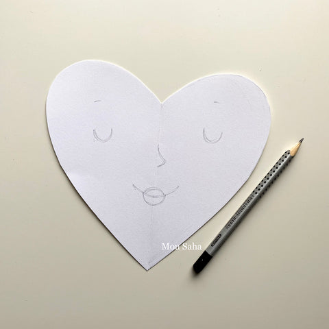 paper heart with face and graphite pencil