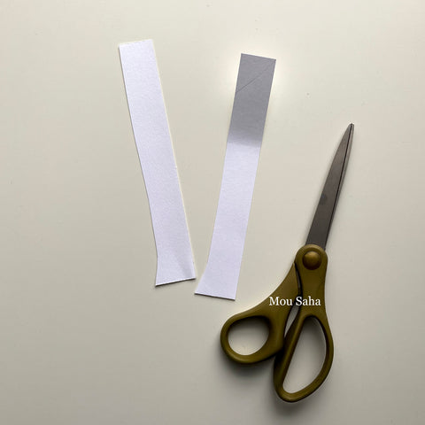 Two paper strips and scissors