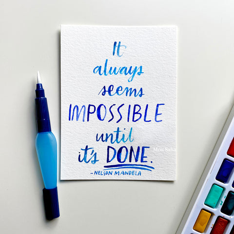 Hand lettering and a watercolor pan