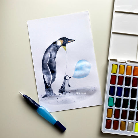 Watercolor penguins with watercolor pan and brush