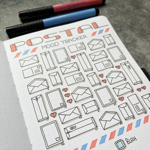 Bullet Journal with postal mood tracker icons and Pitt Artist Pens