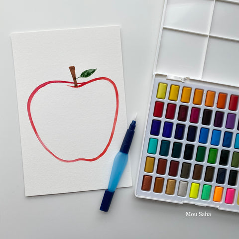 Watercolor pan with apple outline