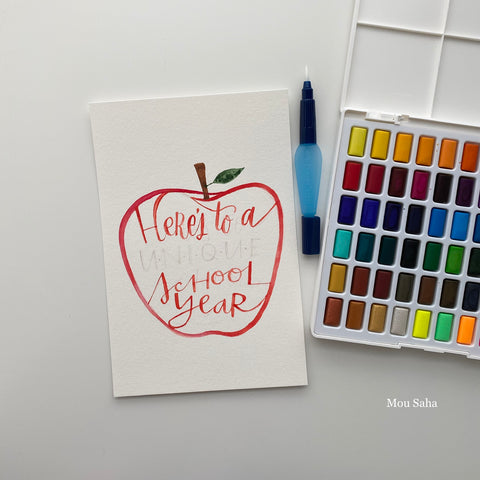 Watercolor pan with hand lettering in apple