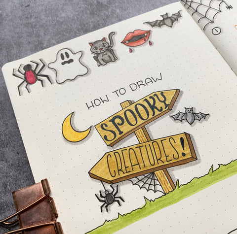 Spooky Creatures Doodles Including Spiders, Ghost, Moon, Cat, and Bats