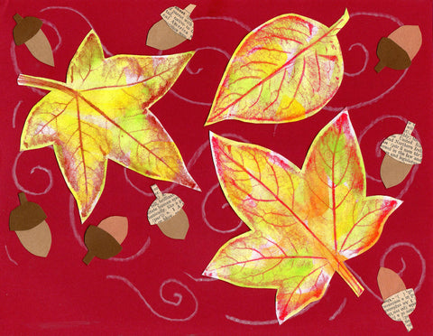 Watercolor paint leaves on construction paper