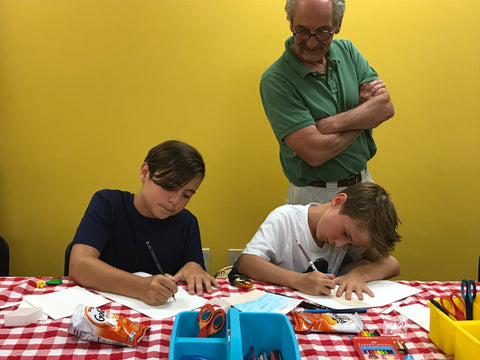 Two Children Coloring with Instructor