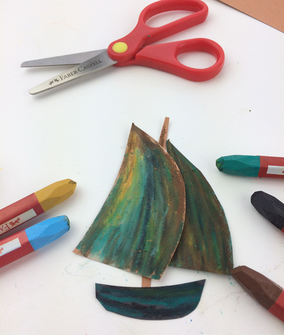 Construction paper boat with oil pastels