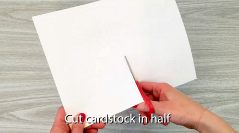 Cut card stock in half